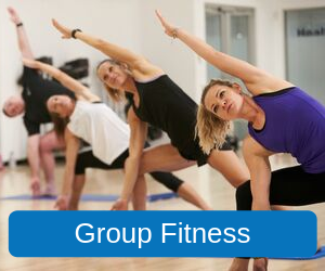 Group Fitness (Image of people attending a group fitness class in the middle of a yoga pose)