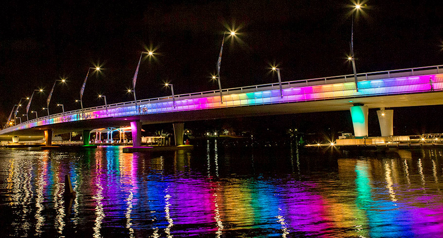 The New Mandurah Bridge at night with multi-colour lighting