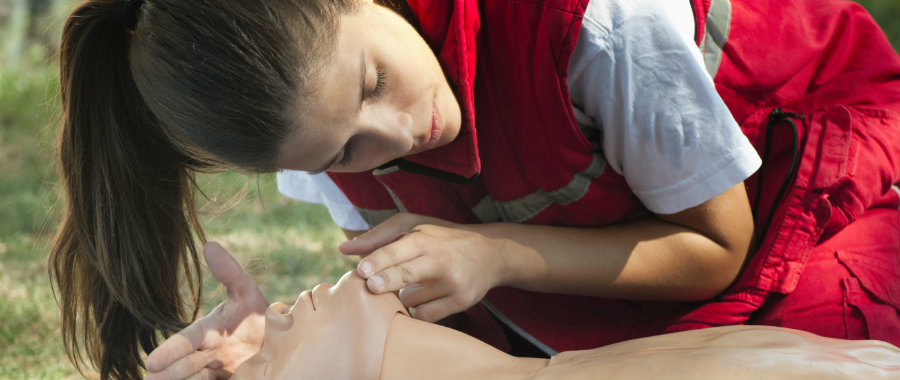 Woman performing cardiopulmonary resuscitation (CPR)