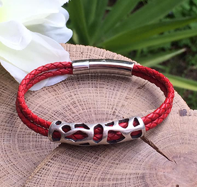 Red leather bracelet with laced metal decoration