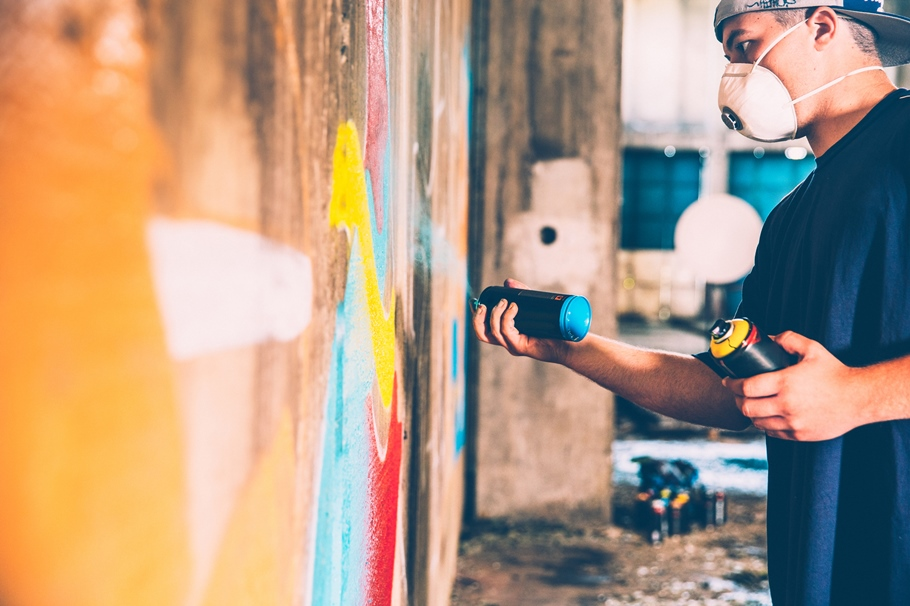 Man spray painting on a wall