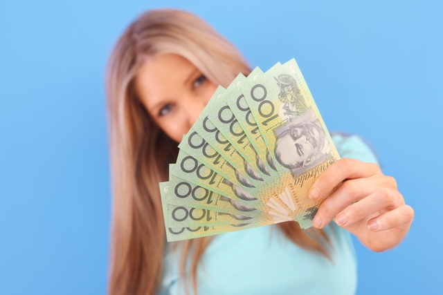 Woman holding Australia one hundred dollar notes with blue background