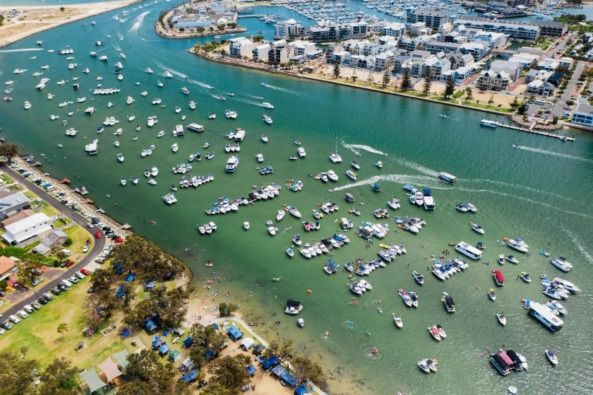 Aerial photo of large number of boats in the estuary for the Australia Day Flotilla event