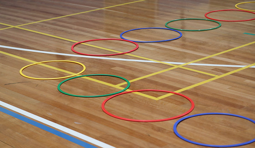 Gym court with lines and hoops